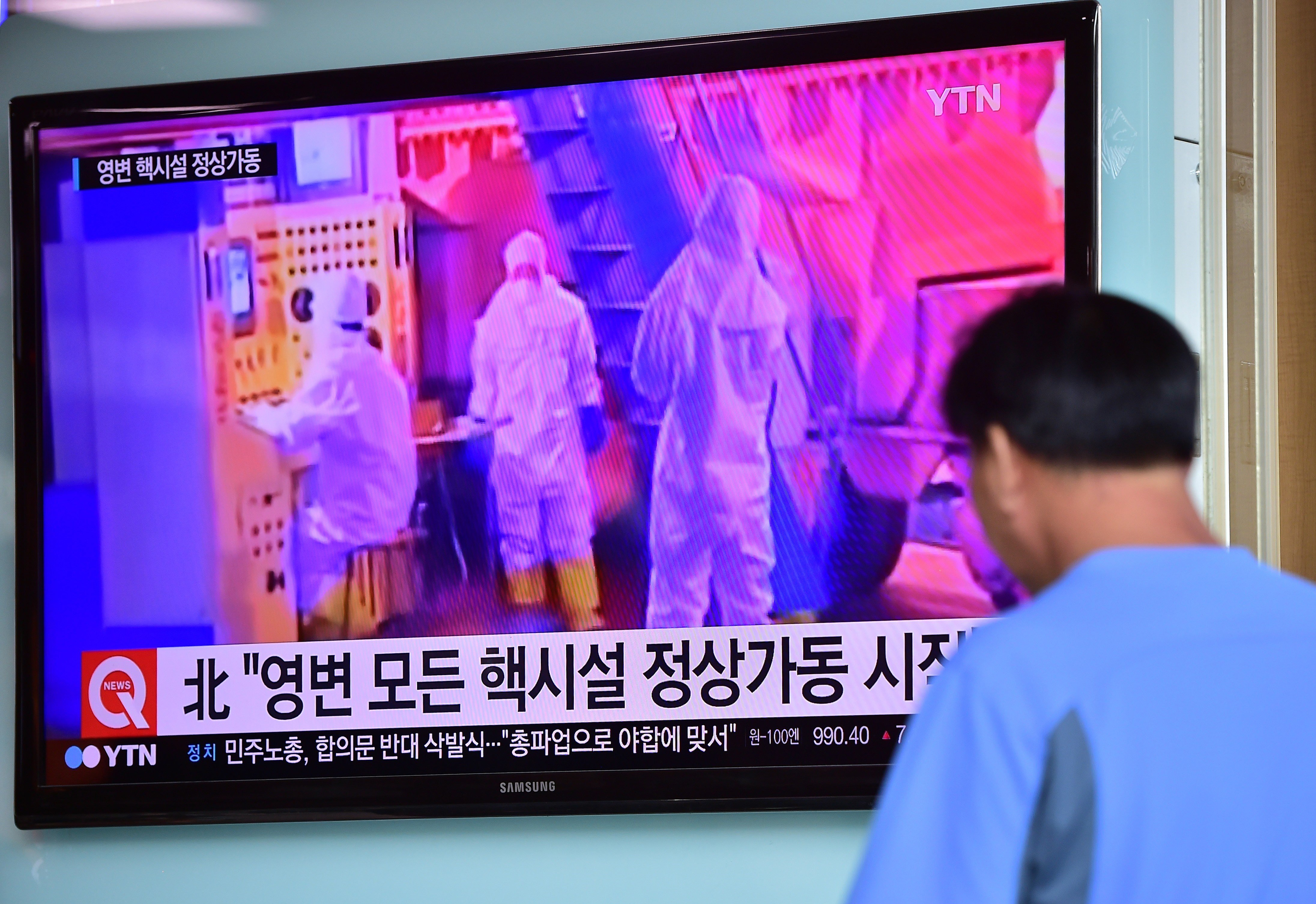 "A man in Seoul, South Korea, watches a news report September 15, 2015, on North Korea's declaration that it had resumed normal operations at the Yongbyon nuclear complex and that the nation is improving the ""quality and quantity"" of its nuclear arsenal. [Photo credit: Jung Yeon-Je/AFP/Getty Images]"