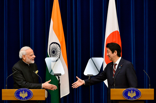 Indian Prime Minister Narendra Modi and his Japanese counterpart Shinzo Abe shake hands during a joint press conference at Abe's official residence in Tokyo on November 11. (Photo credit: Franck Robichon/AFP/Getty Images)
