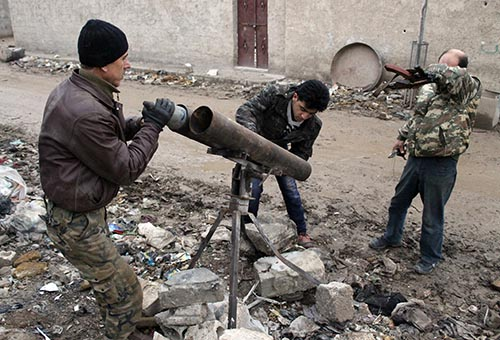 Rebels prepare a homemade rocket launcher during clashes with government forces near the airport on the outskirts of the northern Syrian city of Aleppo on January 27. (ZEIN AL-RIFAI/AFP/Getty Images)