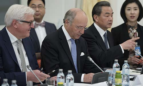 Left to right, German Foreign Minister Frank-Walter Steinmeier, French Foreign Minister Laurent Fabius, and Chinese Foreign Minister Wang Yi attend a November 24 session of the Vienna talks on Iran's nuclear program. Their countries are members of the P5+1, which also includes Russia, the United Kingdom, and the United States. (JOE KLAMAR/AFP/Getty)