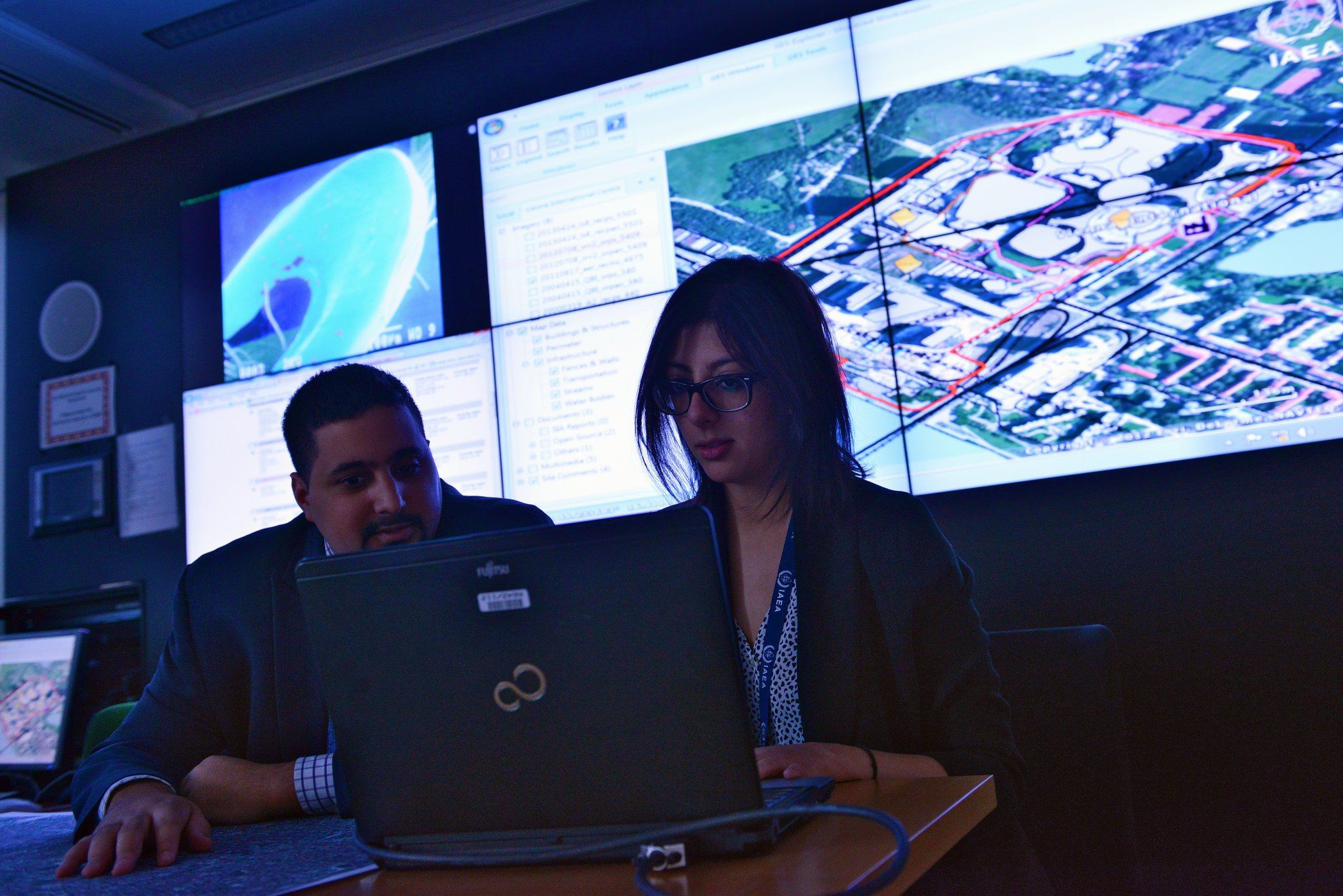 IAEA staffers analyze satellite imagery at the agency's Vienna headquarters on March 19. (Dean Calma/IAEA)