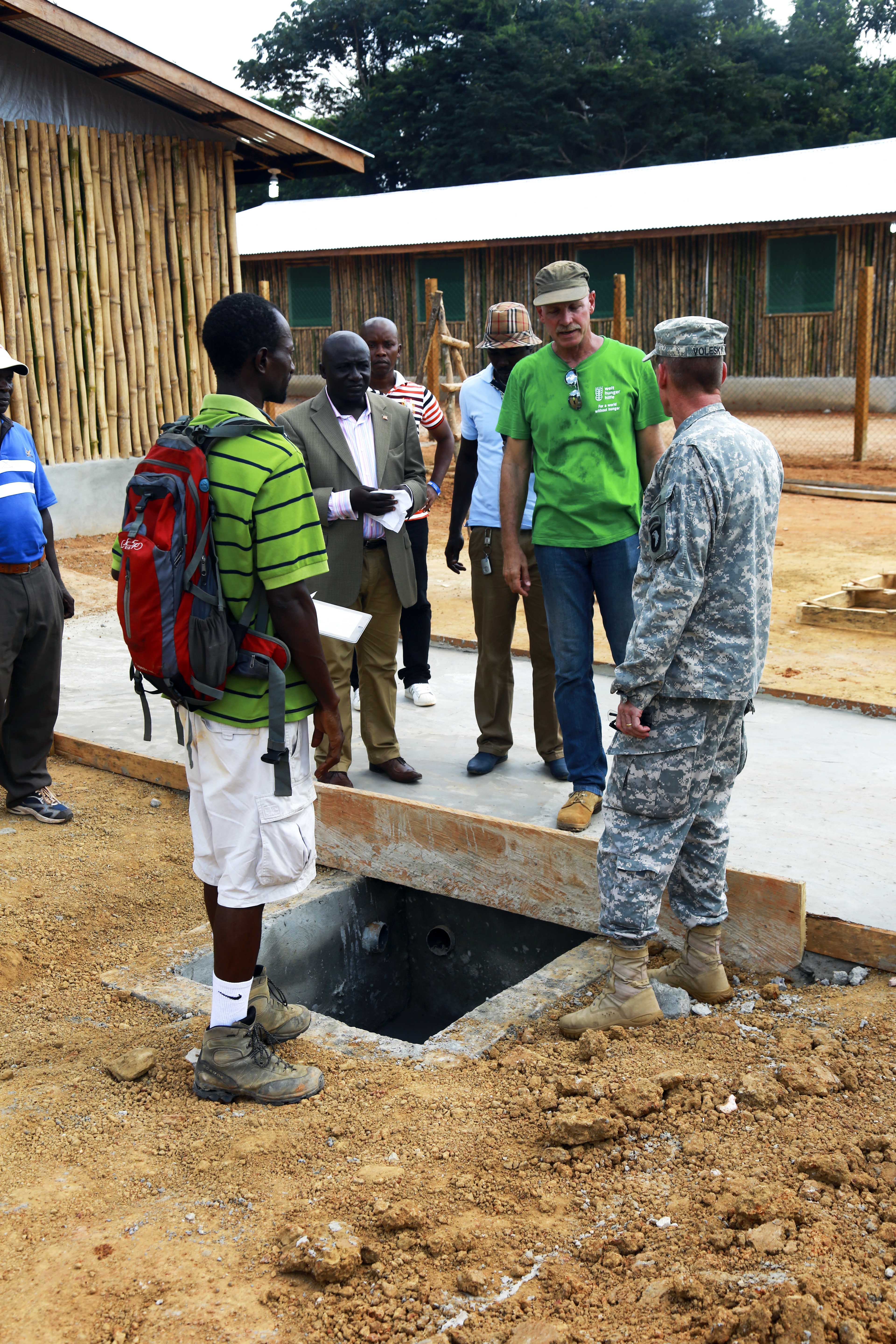 A U.S. Army officer meets with local officials and representatives of international aid organizations to discuss a new Ebola treatment unit in Zwedru, Liberia, on December 10, 2014. (U.S. Army photo by Sgt. 1st Class Brien Vorhees)
