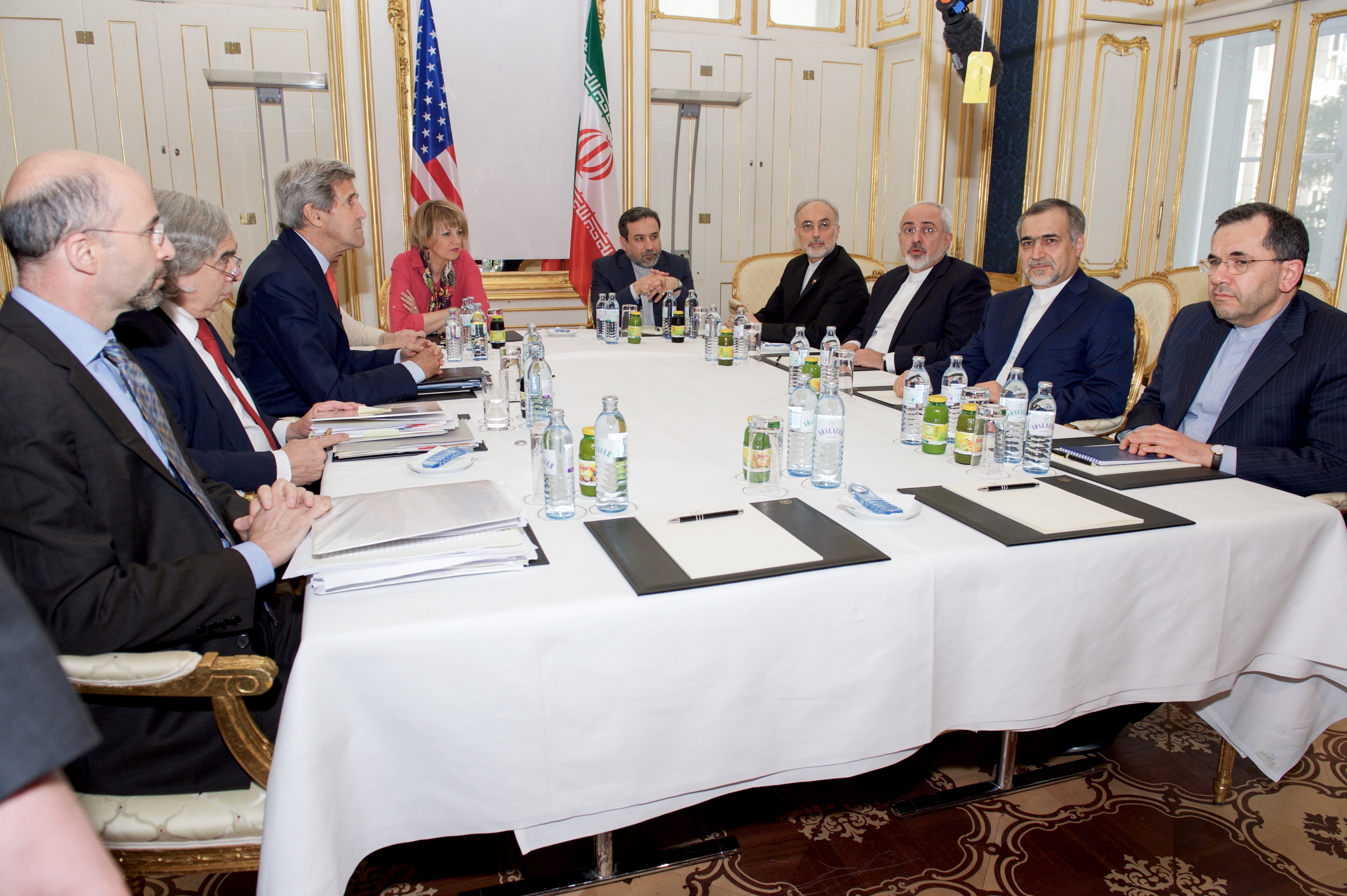 Iranian Foreign Minister Mohammad Javad Zarif (third from right) speaks to reporters during a break in talks with the U.S. delegation, headed by Secretary of State John Kerry (third from left) in Vienna on July 3.  At Kerry's left is Helga Schmid, deputy foreign policy chief for the European Union. (State Department Photo)