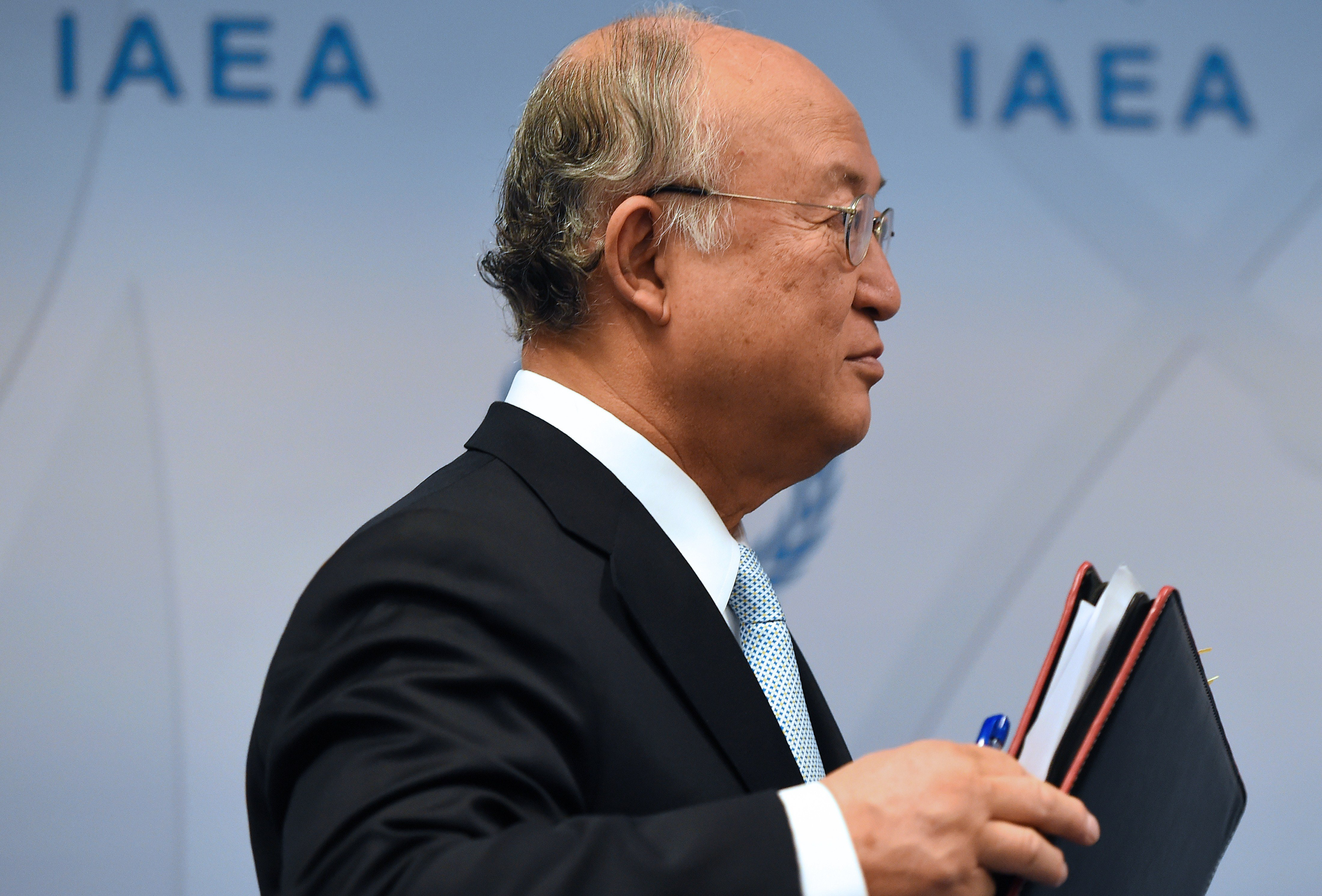 Yukiya Amano, director-general of the International Atomic Energy Agency, participates in a press conference at IAEA headquarters in Vienna on June 8. (JOE KLAMAR/AFP/Getty Images)