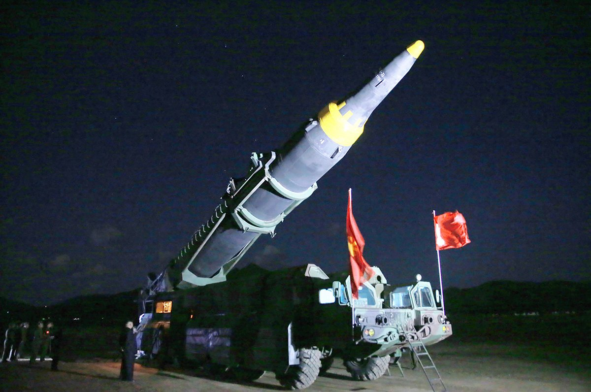 "This May 14 picture from the official Korean Central News Agency shows leader Kim Jong Un inspecting a Hwasong-12 ballistic missile before a test launch. The test was intended to verify ""the tactical and technological specifications"" for a system ""capable of carrying a large-size heavy nuclear weapon,"" according to the state-run news agency. (Photo credit: Stringer/AFP/Getty Images)"