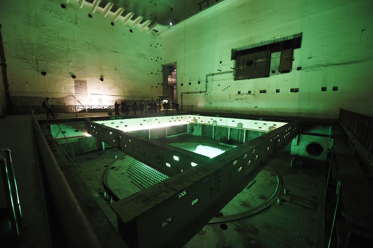 Visitors tour China's once-secret 816 Nuclear Military Plant, a vast underground facility that had been intended to contain a reactor producing weapons-usable plutonium. The project was cancelled in 1984, before completion, and the complex of caves and tunnels was opened as a tourist site in 2010. This photo taken February 21 shows the room that was to house the reactor. (Photo credit: Wang Zhao/AFP/Getty Images)