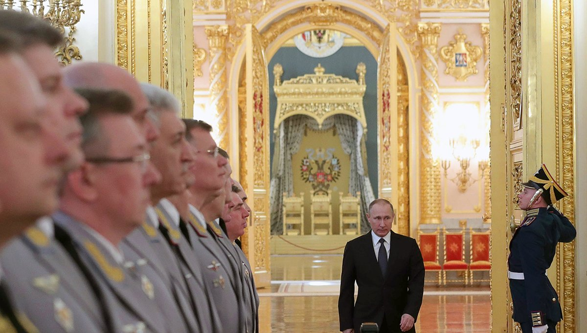Russian President Vladimir Putin enters a hall in the Kremlin March 23 to meet with senior military officers promoted to higher positions. (Photo credit: Mikhail Klimentyev/AFP/Getty Images)