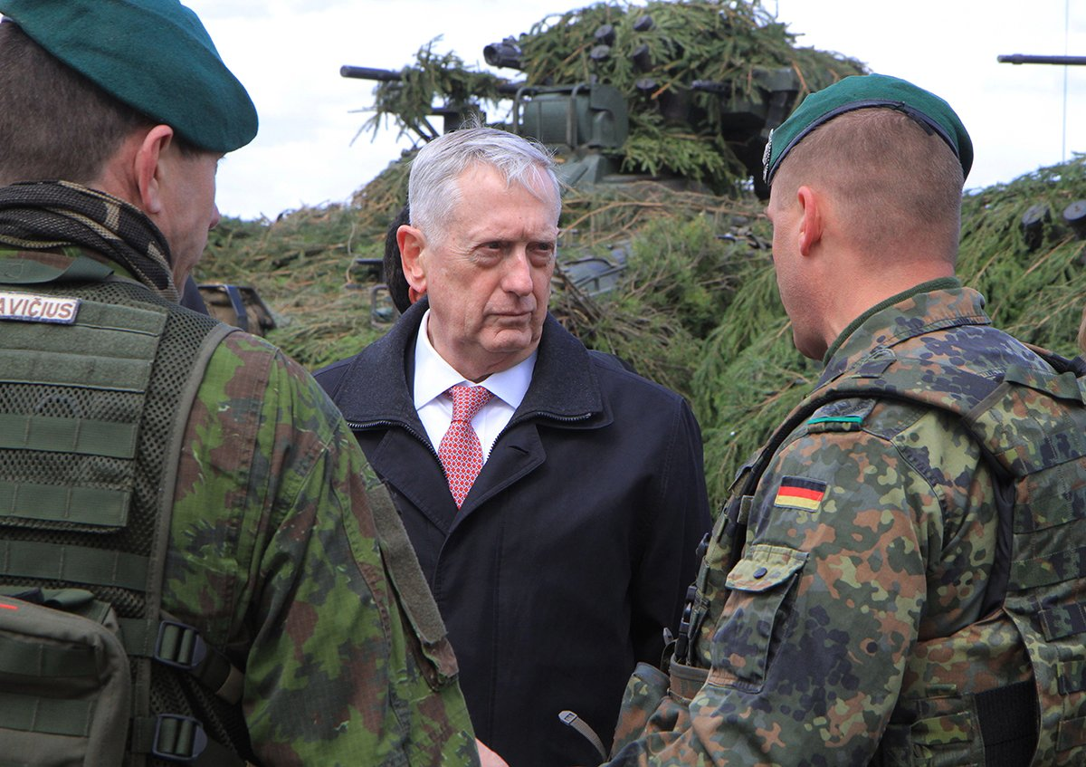 U.S. Defense Secretary Jim Mattis talks with soldiers during a visit to NATO's enhanced Forward Presence Battlegroup in Lithuania on May 10. The United States and its European allies have increased their military presence in response to perceived Russian threats to nearby NATO members, such as the Baltic states. (Photo credit: Petras Malukas/AFP/Getty Images)