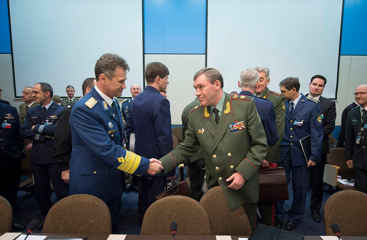 General Stefan Danila (left), chief of the Romanian Army General Staff, shakes hands with General Valery Gerasimov, chief of the General Staff of the Armed Forces of Russia and first deputy defense minister, at the NATO-Russia Council meeting of defense chiefs on January 22, 2014. Shortly thereafter, NATO suspended the council in response to Russia's military actions against Ukraine. (Photo credit: NATO)