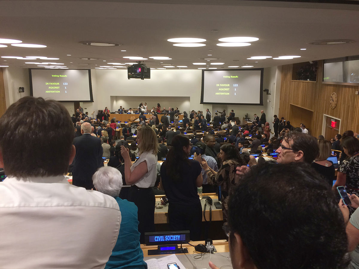 Delegates and observers applaud at the United Nations moments after the Treaty on the Prohibition of Nuclear Weapons is adopted July 7 by a vote 122 in favor, 1 against, and 1 abstention.  (Photo credit: Alicia Sanders-Zakre/Arms Control Association)