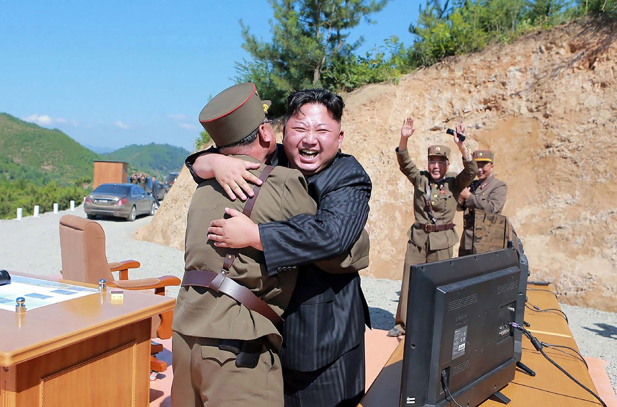 North Korean leader Kim Jong Un celebrates the successful July 4 test of the Hwasong-14 intercontinental ballistic missile in a photo from the official Korean Central News Agency. (Photo credit: Stringer/AFP/Getty Images)