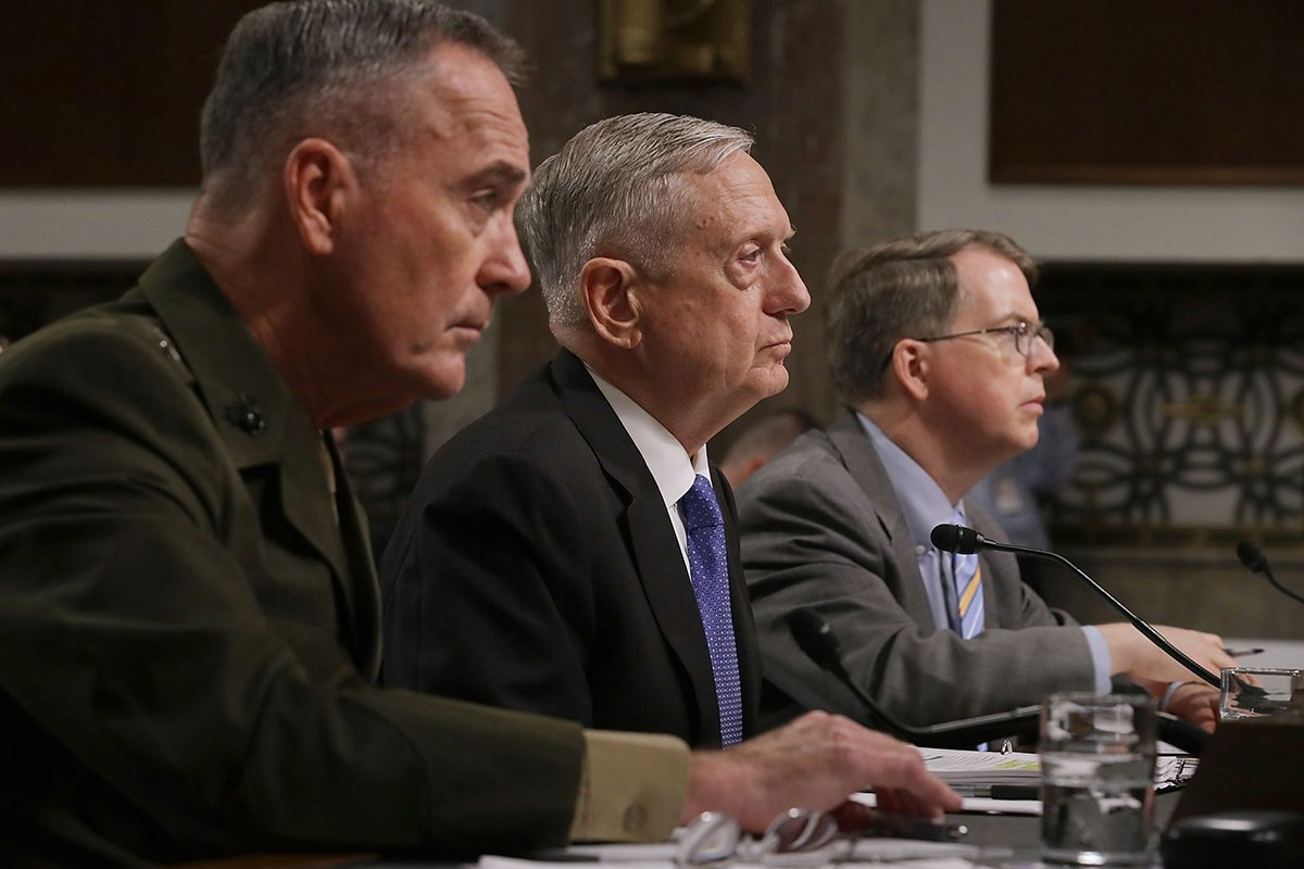 Defense Secretary James Mattis, flanked by Chairman of the Joint Chiefs of Staff Gen. Joseph Dunford (left) and Under­secretary of Defense (Comptroller) David Norquist, testifies June 13 at a Senate Armed Services Committee hearing on the administration's defense budget request. (Photo credit: Chip Somodevilla/Getty Images)