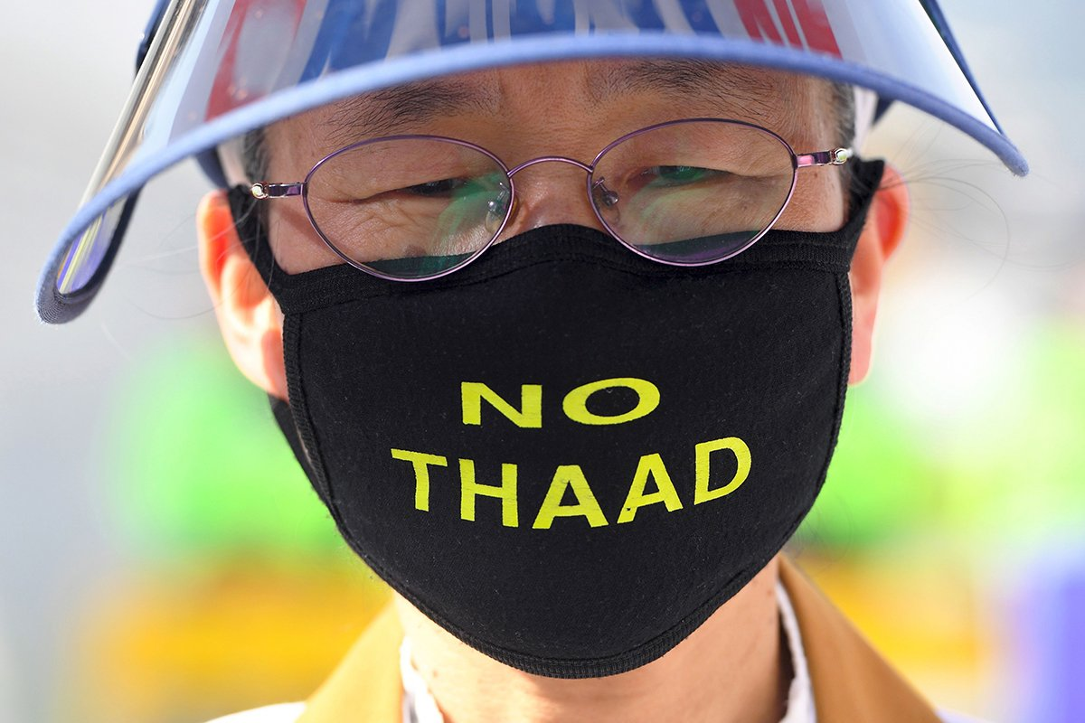 A South Korean protester wears a 'No THAAD' face mask during an April 28 rally in Seoul against the deployment of the U.S. Terminal High Altitude Area Defense (THAAD) system. (Photo credit: Jung Yeon-Je/AFP/Getty Images)