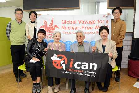 Three survivors of the U.S. atomic bombs dropped on Hiroshima and Nagasaki in 1945 pose with their supporters October 6 in Tokyo to congratulate ICAN on being awarded the 2017 Nobel Peace Prize. Fihn has said the award also honors the elderly hibakusha, who embody the humanitarian aspects of the campaign.  (Photo credit: STR/AFP/Getty Images)