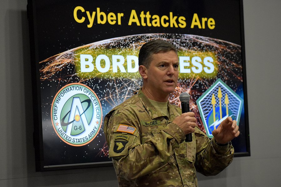 U.S. Army Brigadier General Joseph P. McGee, Army Cyber Command deputy commanding general for operations, talks with audience members about global cyber operations at the 2017 Association of the U.S. Army annual meeting in Washington.  (Photo: U.S. Army Cyber Command)
