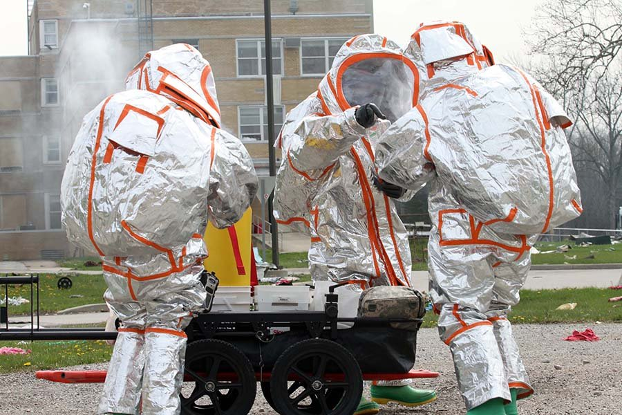 U.S. Army soldiers, dressed in metallic protective suits, conduct a radiation-reconnaissance activity April 22 during Guardian Response 18, a training exercise to validate Army units' ability to support civil authorities in the event of a chemical, biological, radiological, or nuclear event. (U.S. Army Reserve photo by Staff Sgt. Christopher J. Sofia, 78th Training Division)