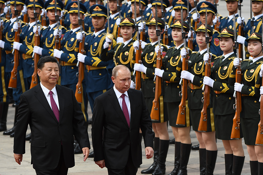 Chinese President Xi Jinping (left) and Russian President Vladimir Putin review a military honor guard during Putin's visit to Beijing on June 8, 2018. The two leaders appear unlikely to participate in a U.S. initiative to identify barriers to nuclear disarmament. (Photo: Greg Baker/AFP/Getty Images)