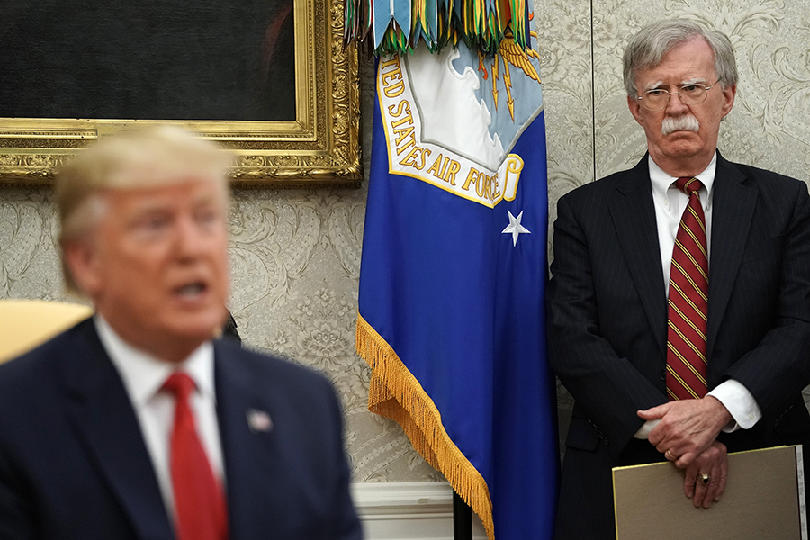 National Security Advisor John Bolton (right) listens to U.S. President Donald Trump at a July 18 White House meeting. Recent Bolton comments have created doubt that the United States will seek to extend New START. (Photo: Chip Somodevilla/Getty Images)