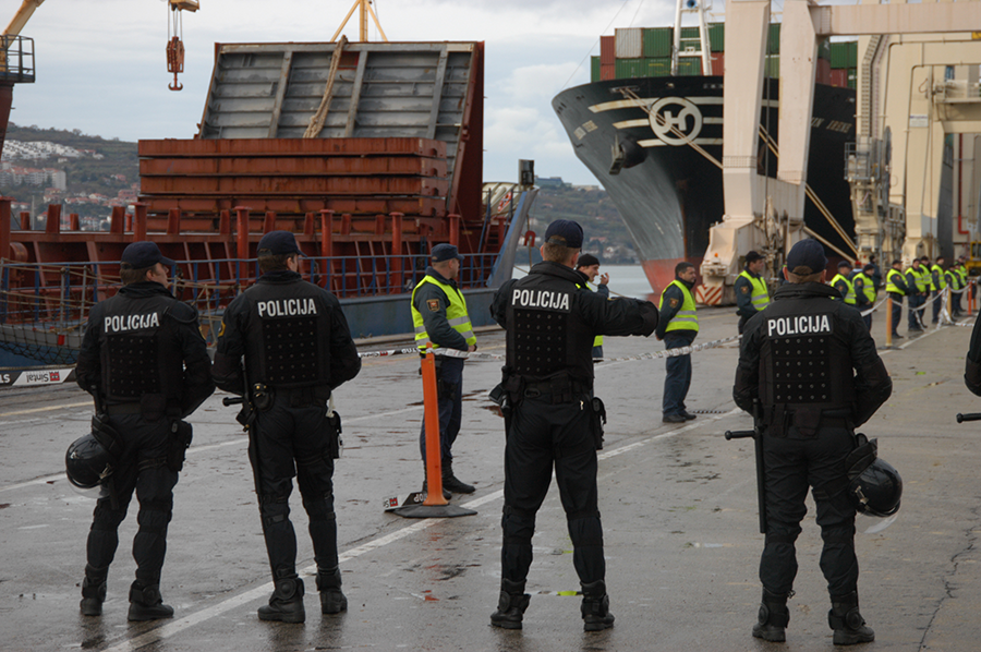Slovenian police protect a ship-loading operation at the port of Koper on Nov. 21, 2010. Highly enriched uranium removed from a Serbian research reactor had been transferred to the port on its way to Russia for disposition. Under the nuclear security summit process, 13 nations eliminated their holdings of highly enriched uranium and separated plutonium. (Photo: Greg Webb/IAEA)